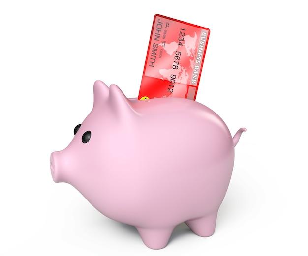 Salvadanaio con carta di credito su sfondo bianco