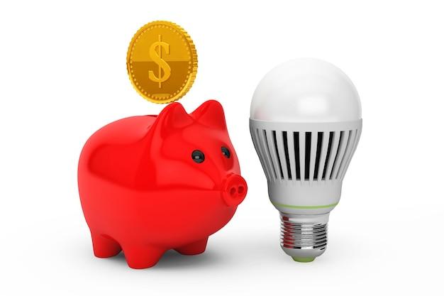 Salvadanaio con lampadina e moneta d'oro su sfondo bianco