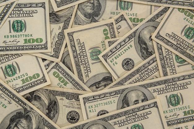 Mucchio di banconote da un dollaro americano come sfondo finanziario. concetto di business