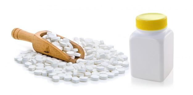 Pillole che fuoriescono dalla bottiglia di pillola