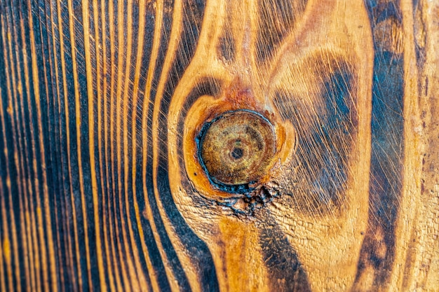 Legno di pino bruciato. macro di struttura del pavimento in legno