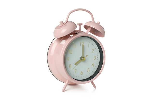 Sveglia rosa isolata su sfondo bianco