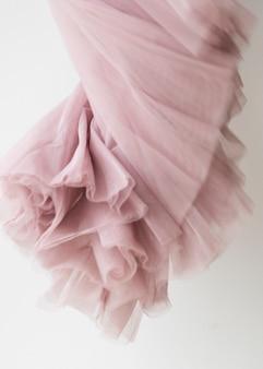 Fondo rosa di struttura del tessuto chiffon