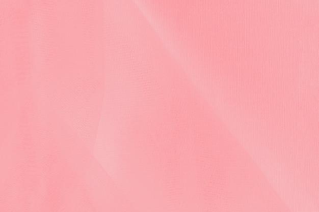 Sfondo di colore rosa corallo con trama del tessuto a rete