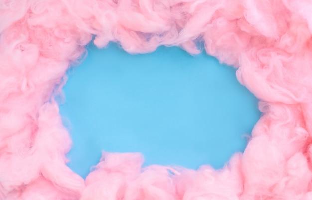Sfondo di lana di cotone rosa, texture dolce zucchero filato soffice morbido colore astratto con lo spazio della copia