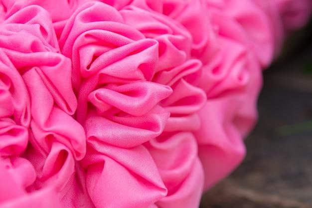 Le tende rosa hanno fatto i fiori, fondo di struttura.
