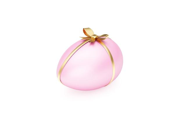 Uovo di pasqua rosa con nastro dorato e fiocco isolato su priorità bassa bianca