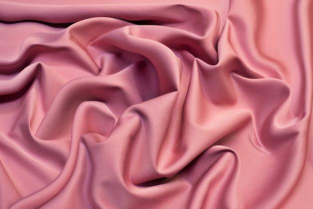 Priorità bassa di struttura del tessuto rosa