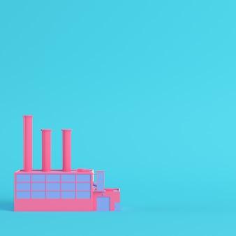Fabbrica rosa su sfondo blu brillante
