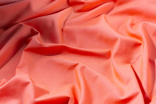 Priorità bassa di struttura del tessuto di seta oro rosa