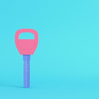 Tasto rosa su sfondo blu brillante in colori pastello. concetto di minimalismo. rendering 3d