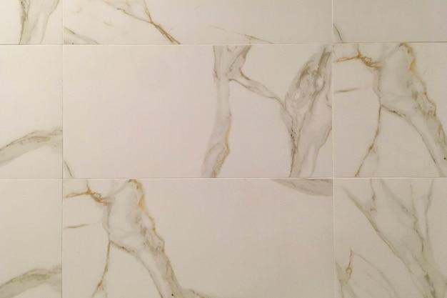 Luce rosa parete o pavimento delle mattonelle di marmo naturale granito struttura astratta e lo sfondo per il design carta da parati di interni per la casa in cucina o in bagno. copia spazio. avvicinamento. al chiuso.