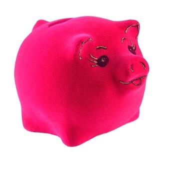 Salvadanaio rosa su sfondo bianco