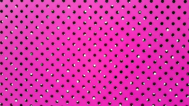 Lamiera rosa con sfondo fori
