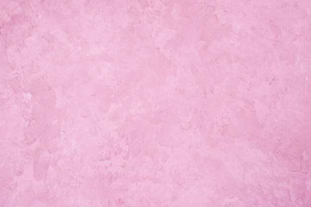 Fondo rosa della parete dello stucco. struttura del muro di cemento verniciato rosa