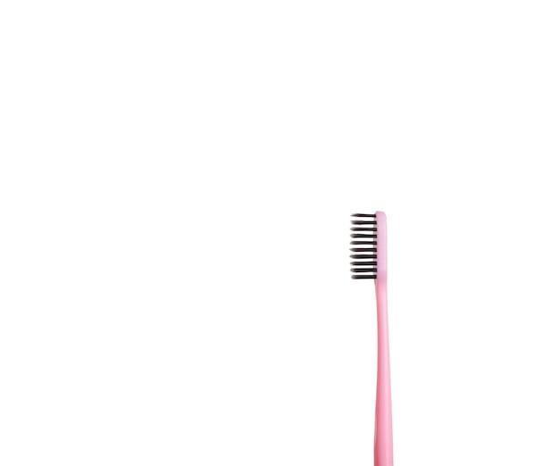 La guancia rosa per lavarsi i denti è isolata su uno sfondo bianco. cura e igiene del cavo orale