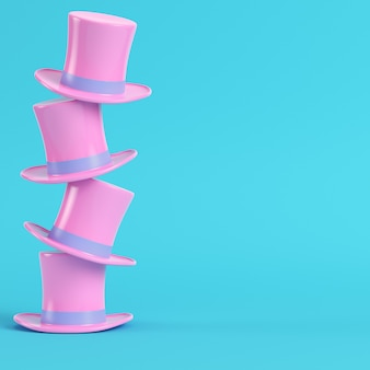 Cappelli a cilindro rosa su sfondo blu brillante
