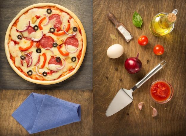 Pizza e ingredienti alimentari al tavolo di legno, vista dall'alto