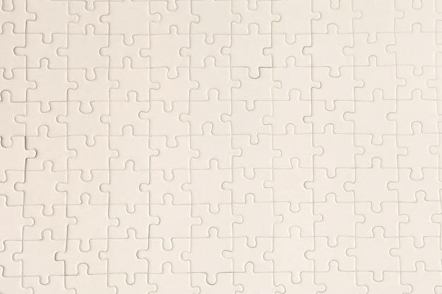Pianifica una superficie puzzle bianca per sfondi strutturati e sfondi astratti. copia spazio per il testo