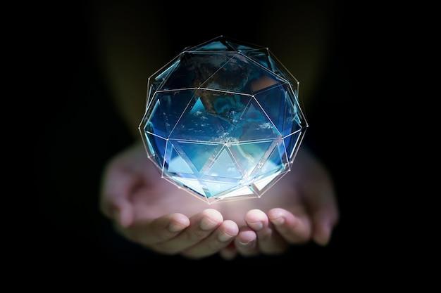 Il pianeta terra in una mano umana