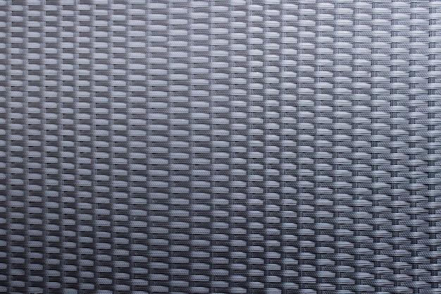 Superficie plaid con motivo in materiale plastico