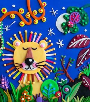 Illustrazione di leone re africano di plastilina fatta a mano di argilla