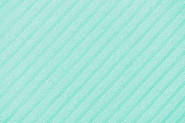 Sfondo plisse tinto in verde biscay. linee di stoffa geometrica. tessuto, tessuto da vicino.