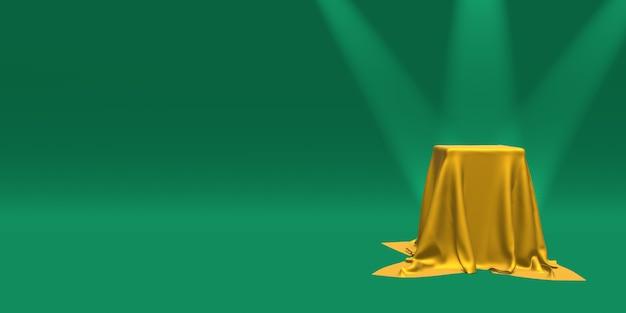 Podio o piedistallo coperto con un panno dorato illuminato da faretti su verde