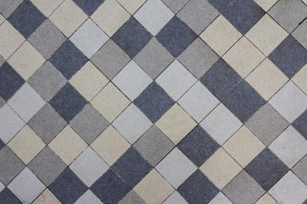 Modello di mosaico di piastrelle piscina. pavimentazione di puzzle. modello astratto di mattoni in ceramica. struttura della superficie della doccia