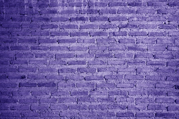 Muro di mattoni del grunge colorato viola in stile pop art per lo sfondo