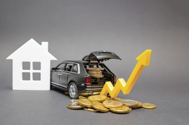 Crescita del reddito della popolazione. auto con monete nel bagagliaio su sfondo nero. freccia rivolta verso l'alto come un concetto per migliorare gli standard di vita.