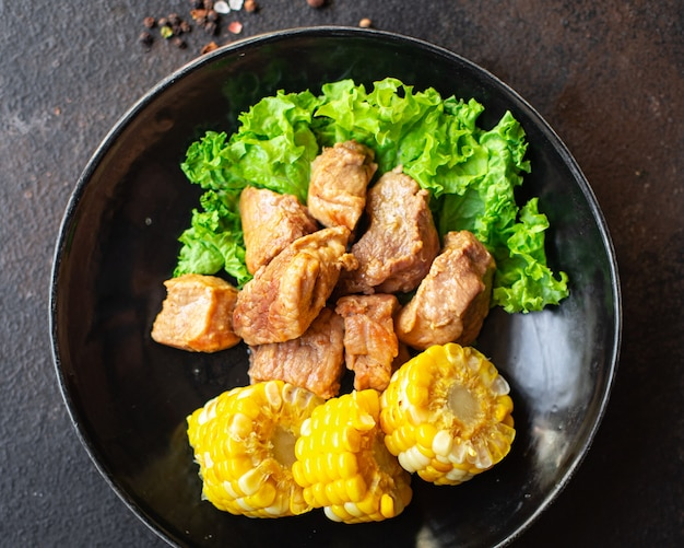 Carne di maiale in umido guarnire pasto spuntino sul tavolo spazio copia sfondo cibo rustico vista dall'alto