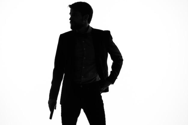 Ritratto di una pistola ombra uomo nelle mani di un crimine detective in incognito