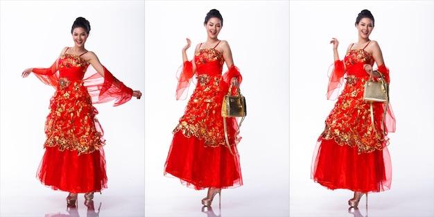 Ritratto di miss asian pageant beauty contest in abito costume gonna strato rosso, sfondo bianco illuminazione studio, gruppo collage pack di corpo integrale isolato
