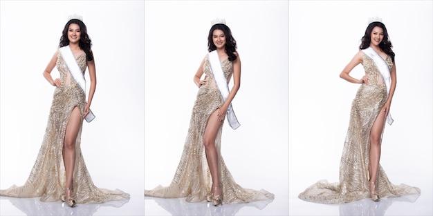 Ritratto di miss asian pageant beauty contest in abito lungo abito da ballo di sera con paillettes con corona di diamanti di luce scintillante, sfondo bianco di illuminazione da studio, confezione di gruppo collage di corpo integrale isolato