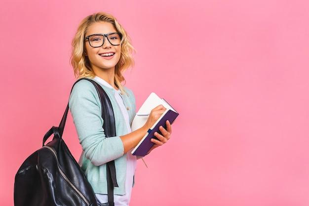 Ritratto di sorridente scuola ragazza bambino bambino con la borsa di scuola e libri