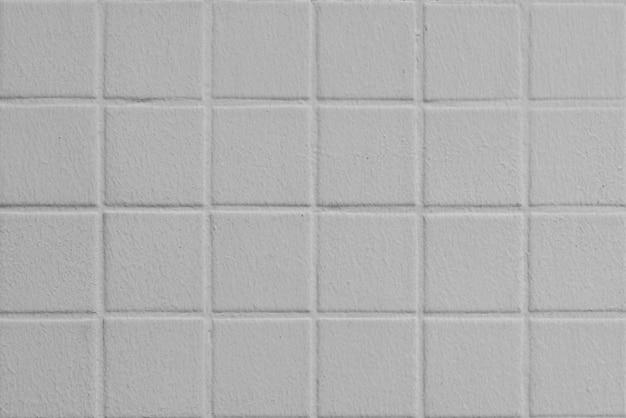 Ritratto di muro di piastrelle bianche in piazze senza soluzione di continuità come sfondo astratto