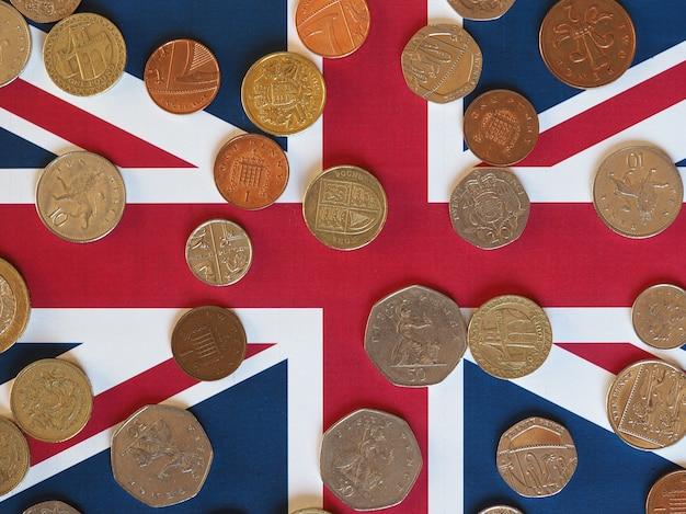 Sterlina monete, regno unito sopra bandiera