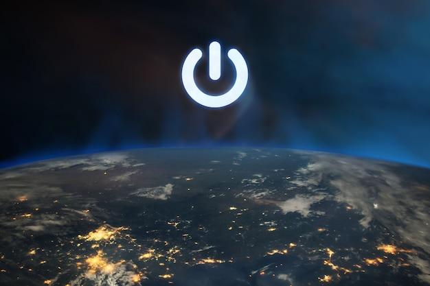 Pulsante di accensione sul pianeta terra nello spazio esterno.