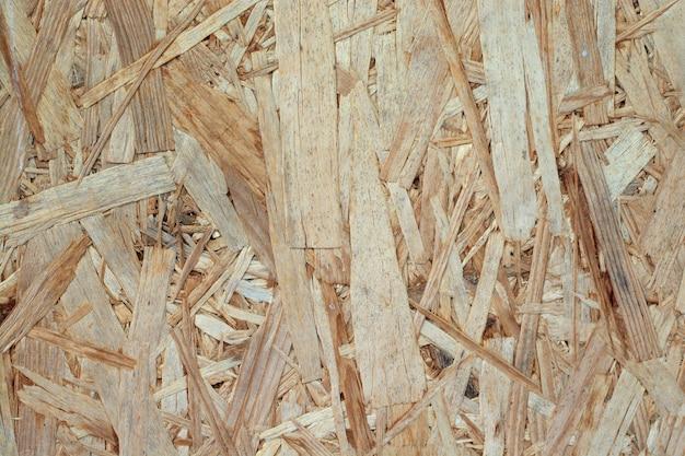 Fondo di legno giallo arancio urgente con struttura.