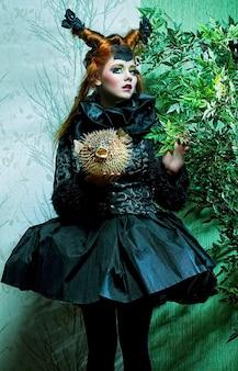 Principessa con palloncini. trucco in stile bambola.