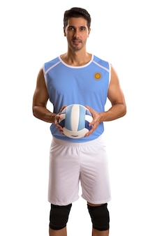Giocatore professionista di pallavolo argentino con palla. isolato su uno spazio bianco.