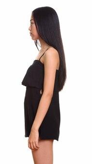 Vista di profilo di giovani asiatici ragazza adolescente in piedi