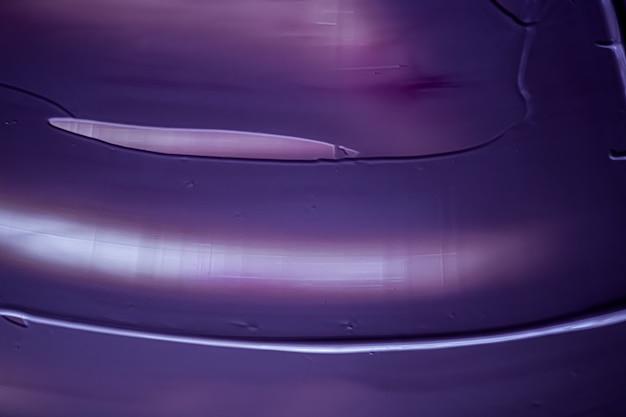 Sfondo crema viola texture prodotto cosmetico e sfondo trucco per vacanze di marca di bellezza di lusso...