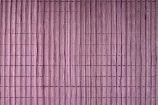 Priorità bassa della stuoia dei sushi di bambù giapponese viola