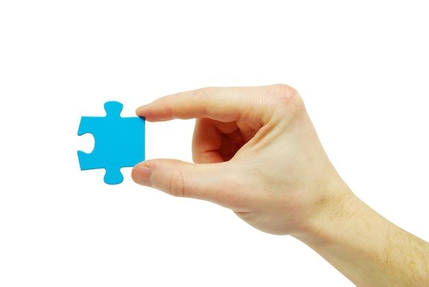 Puzzle in mano isolato