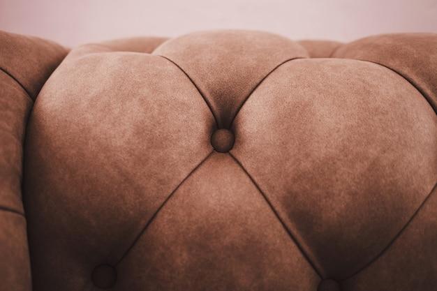 Superficie in tessuto trapuntato. divano morbido primo piano con tessuto di buona qualità