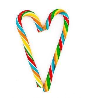 Bastoncino di zucchero colorato arcobaleno isolato