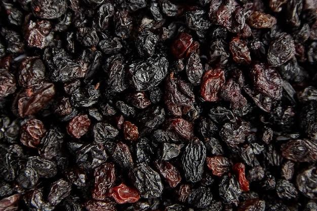 Uvetta texture di sfondo essiccato uva rossa vista dall'alto