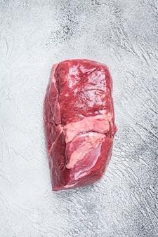 Bistecca di coscia di carne di agnello cruda